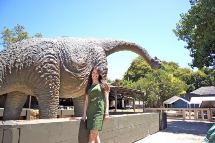 Zoomars Petting Zoo owner Carolyn Franks with the apatosaurus replica she purchased and installed in June. Photo by Brian Park