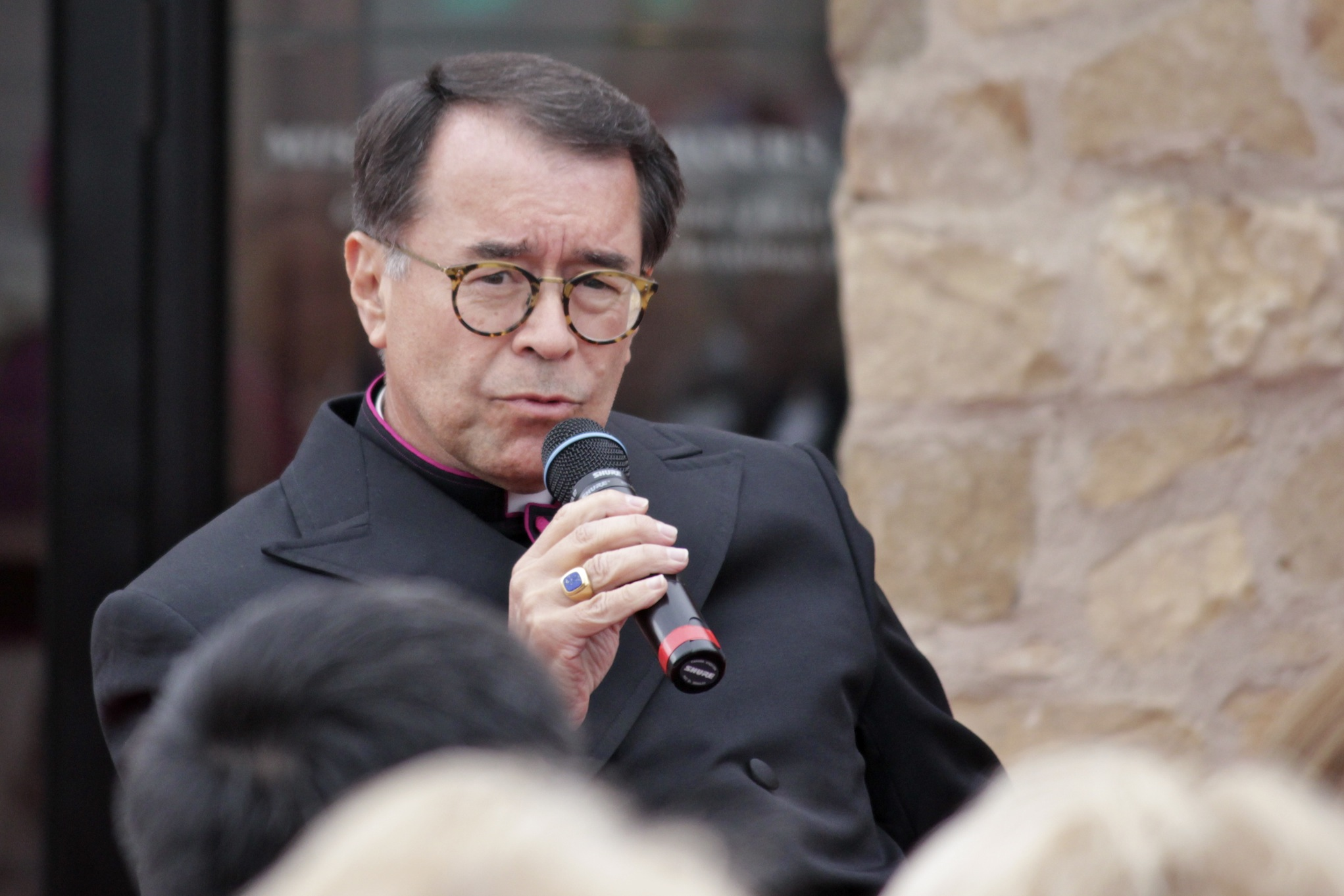 Rev. Monsignor Arthur Holquin speaks to distinguished guests during a ribbon cutting ceremony last March for the Mission's new gatehouse. Photo by Brian Park