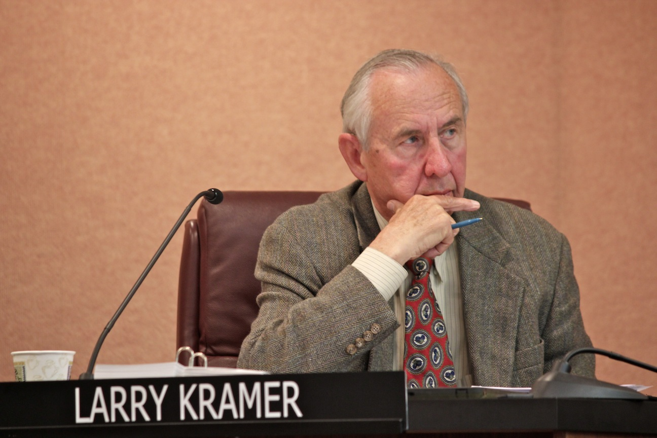 Councilman Larry Kramer hears arguments from supporters and opponents of the Zoomars dinosaur. Photo by Brian Park