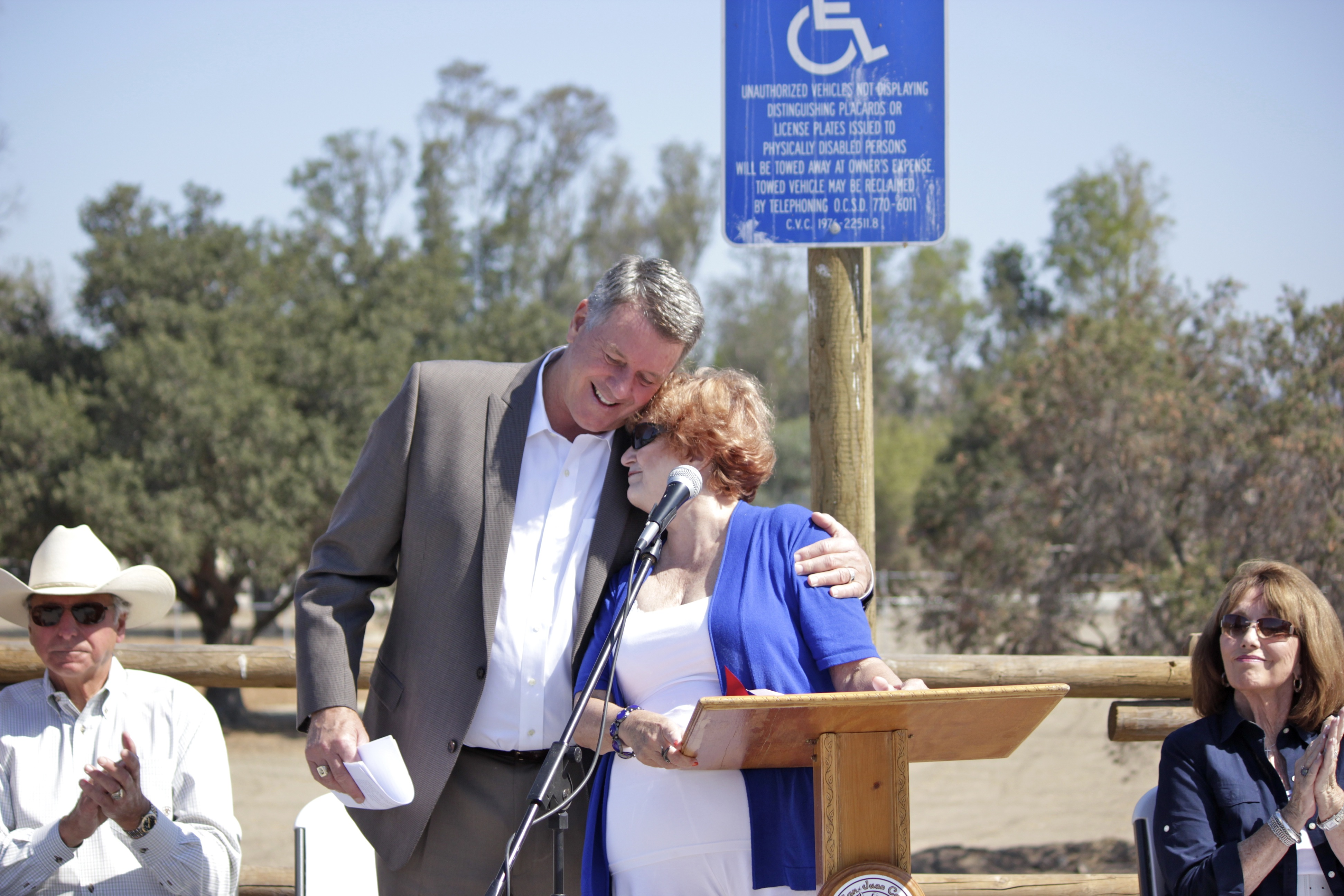 Mayor John Taylor and Goldee Cortese embrace during the grand opening ceremony for the Dr. Joe Cortese Dog Park. Photo by Brian Park