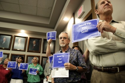 Mayor Pro Tem Sam Allevato's supporters stood by as the councilman addressed an attempt to recall him from the council. Photo by Brian Park