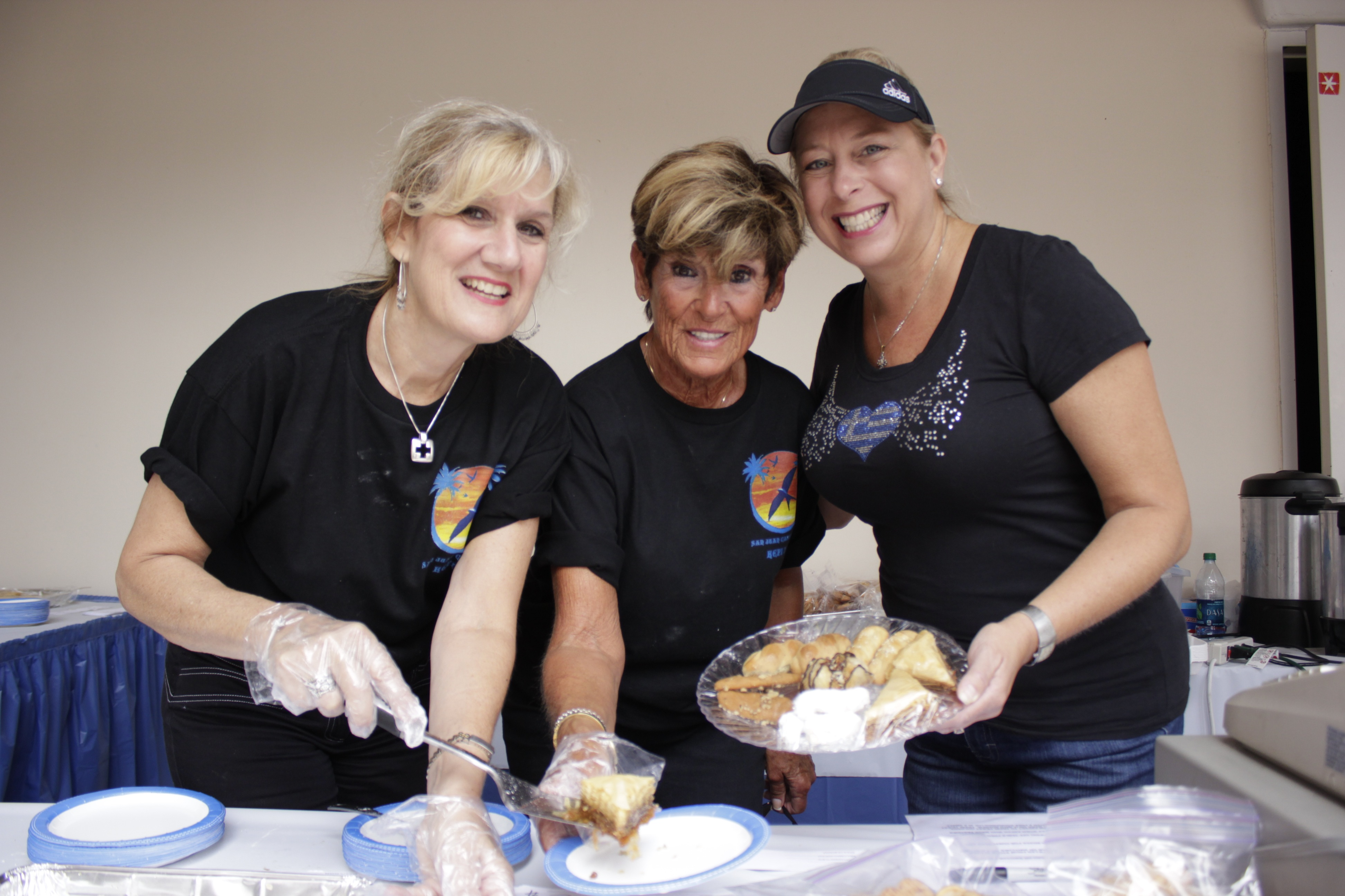 (From L to R) Suzanne Stamos, Frank Karnazes and Caroline Peros were a few of the many volunteers who helped serve guests during the Greek Festival. Photo by Brian Park