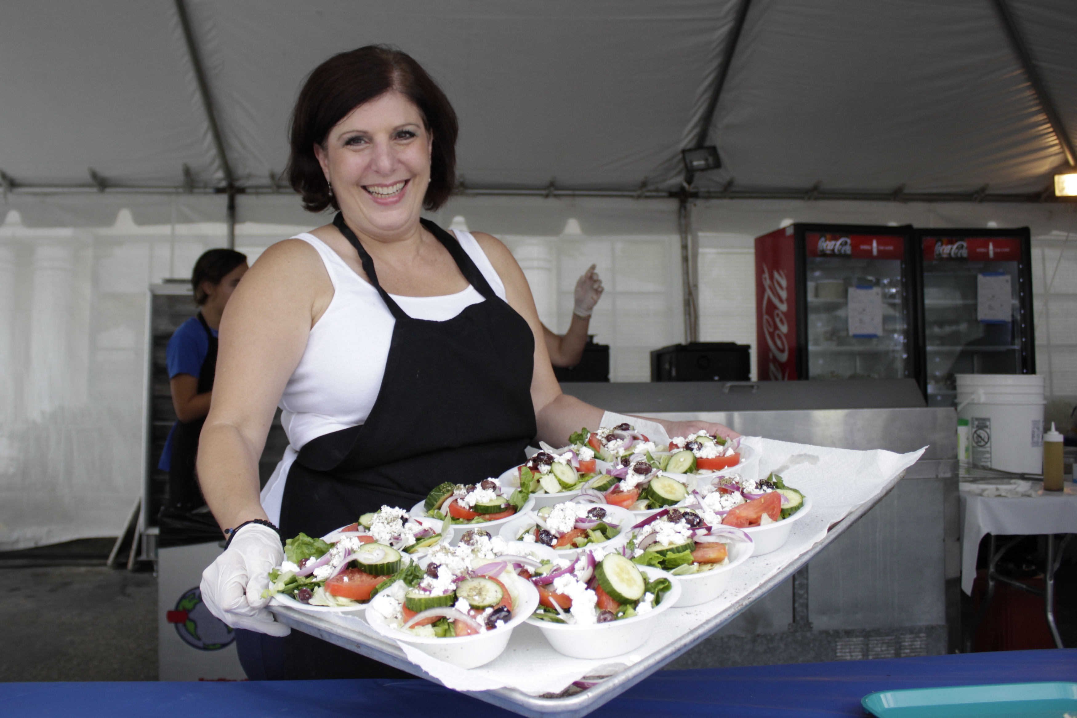 Sandy Rains with a tray of Greek salads. Photo by Brian park