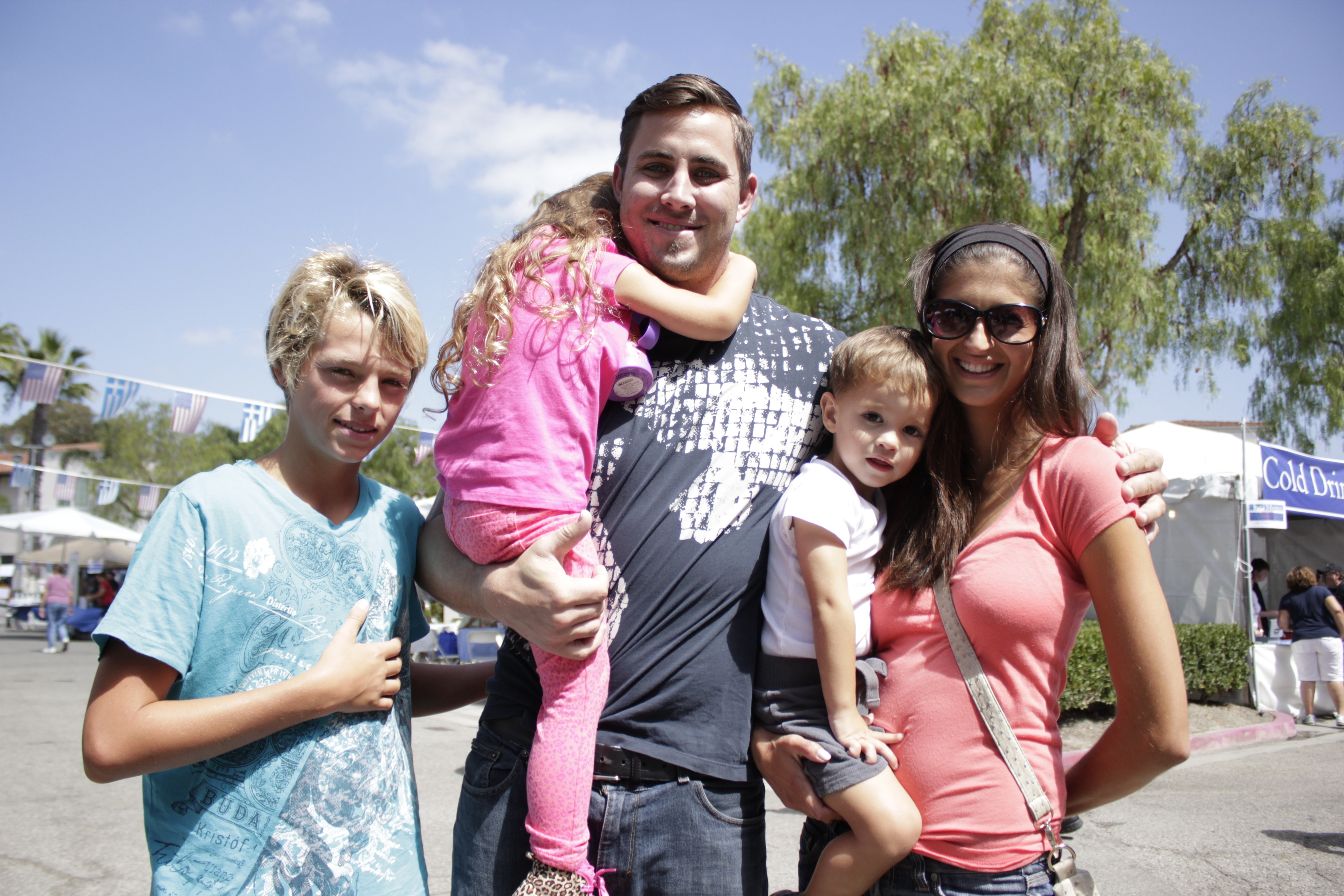 Urban Village's Joshua Host (center) and his family pose for a photo during the Greek Festival. Photo by Brian Park