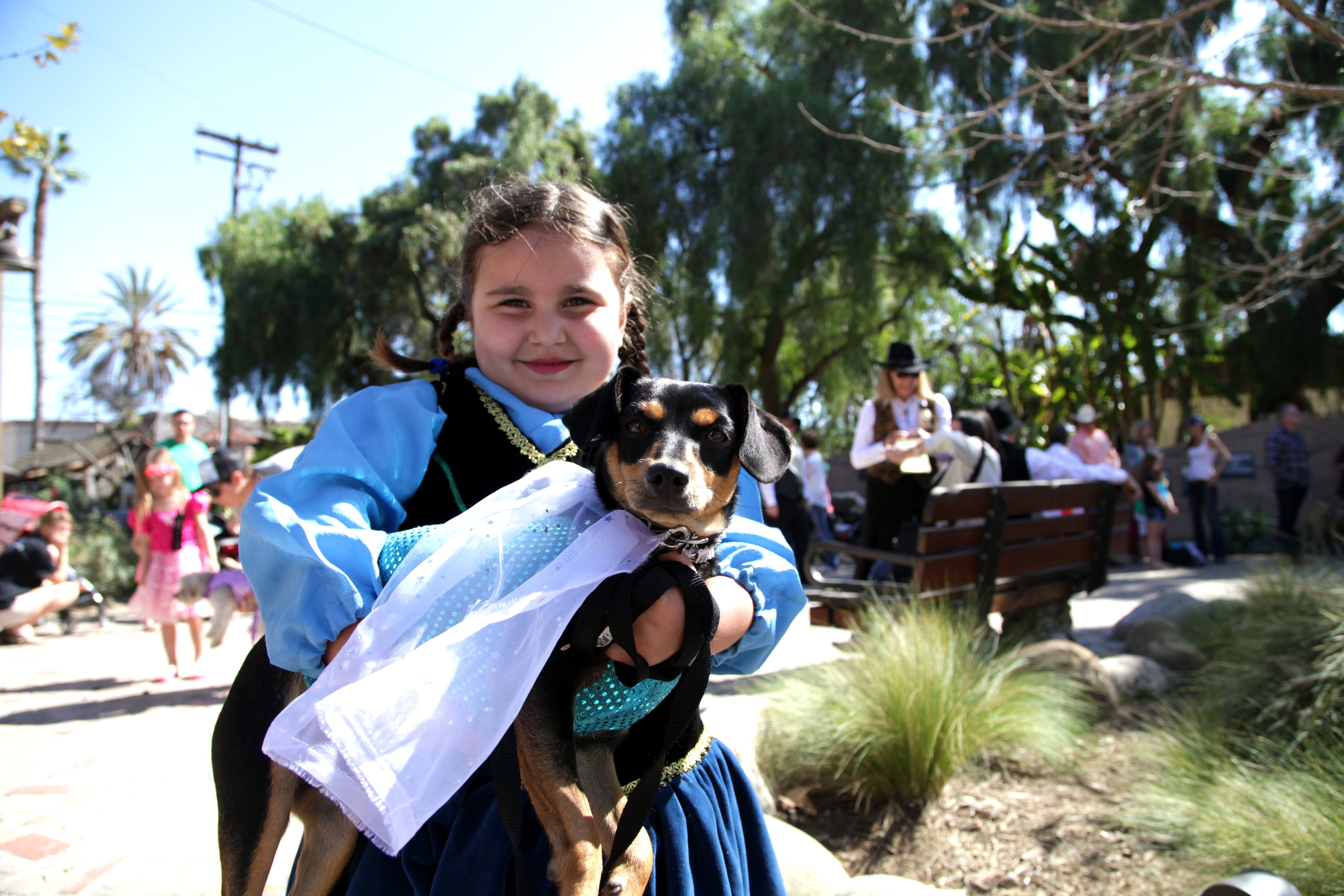 Sophia Maria and her dog, Coco, stop for a photo while going through the parade route. Photo by Brian Park