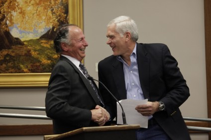 Mayor Sam Allevato, left, shakes hands with outgoing Utilities Commissioner Dan Merkle. Merkle served on the commission for 12 years. Photo by Brian Park