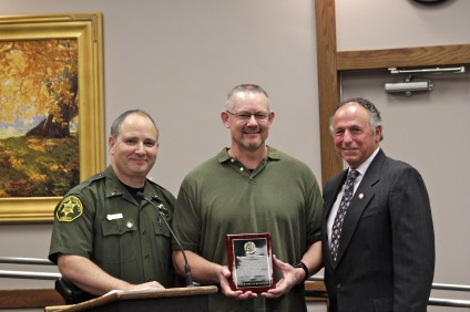 (From L to R) Lt. John Meyer, Sgt. Ira Essoe and Mayor Sam Allevato. Essoe, who is retiring from the Orange County Sheriff's Department after 28 years, was recognized by the City Council on Tuesday, Feb. 18. Photo by Brian Park