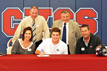 Sam Sukut, along with his family and coaches, signs his National Letter of Intent to play football for the University of San Diego. Photo courtesy of Capistrano Valley Christian Athletics
