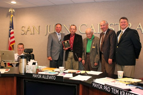 Assistant Director of Development Services Bill Ramsey (third from left) poses for a photo with the San Juan Capistrano City Council during his last council meeting. After 24 years with the city, Ramsey is retiring May 2. Photo by Brian Park
