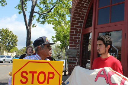 (From L to R) Raymond Herrera, president and founder of We the People California's Crusader, an anti-illegal immigration advocacy group, confronts Edwin Molina, a pro-immigration-reform activist, in San Juan Capistrano. Photo by Catherine Manso