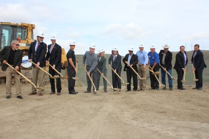 Officials from around Orange County throw up the first dirt for the La Pata extension gap closure project. Photo by Jim Shilander