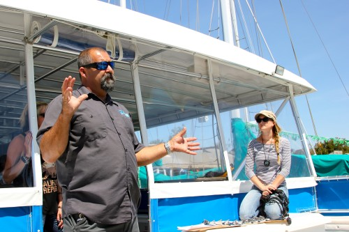 Capt. Todd Mansur, lead naturalist for Dana Wharf Whale Watching and board member of the Gray Whale Foundation, prepares students for their trip aboard the OCean Adventures catamaran.
