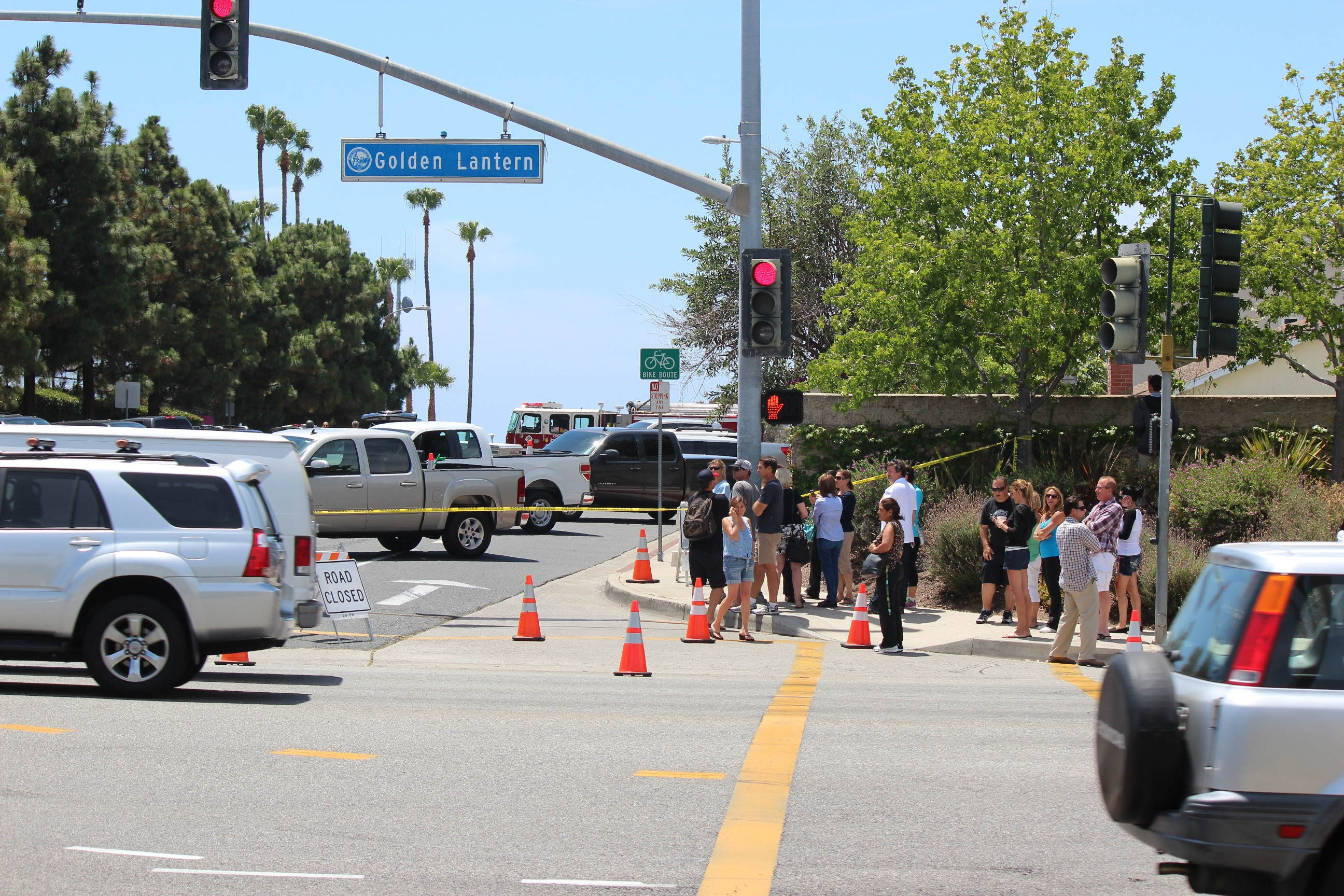 Parents gather near Dana Hills High School Thursday after the discovery of an empty gun case in the parking lot prompted a lockdown and search of the campus by Orange County Sheriff's Deputies. Photo: Jim Shilander