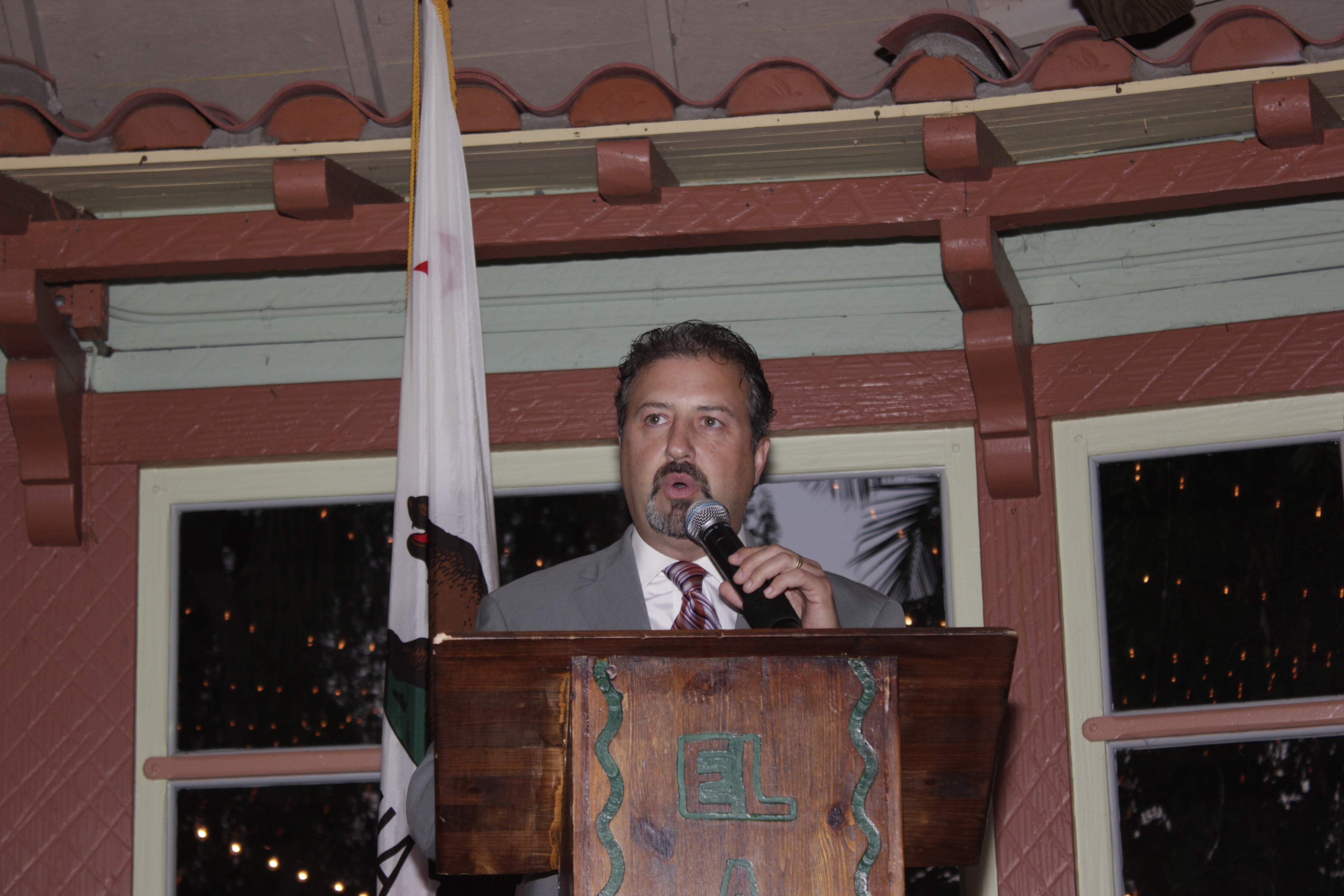 John Gillotti, owner of Mission Grill, delivers a speech after receiving the Chamber of Commerce's 2014 Business of the Year award. Photo: Brian Park