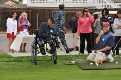 A Wounded Warrior takes part in the Joe Grohman Foundation's golf clinic in 2013. Photo: Eddie Meeks Photography