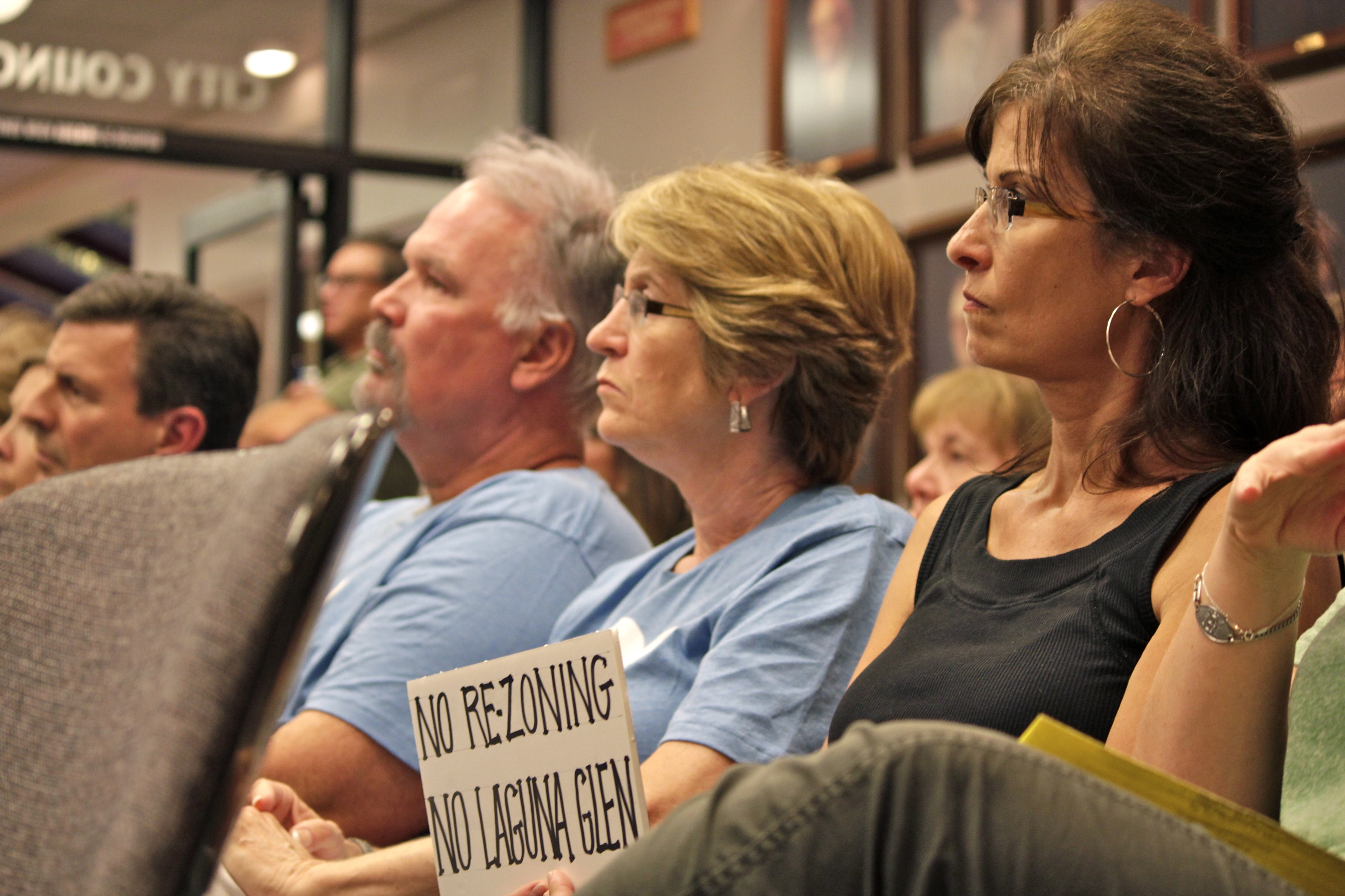 San Juan Capistrano resident Shelley Bachelder holds a sign in protest against Spieker Senior Development's Laguna Glen proposal. Photo: Brian Park