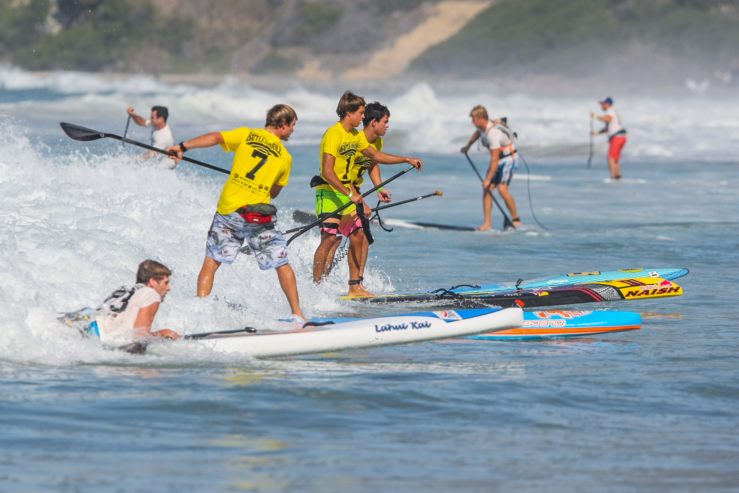 Stand-up paddleboard racers catch a wave at the Battle of the Paddle at Salt Creek Beach. Photo: Tony Tribolet/www.xpsphoto.com