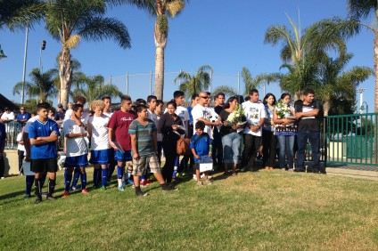 The families of Matthew Melo and Alex Sotelo, two teenagers who died in a car crash last week, stand alongside their son's AYSO U16 soccer team during a pregame ceremony at the Sports Park in San Juan Capistrano. Photo: Steve Breazeale