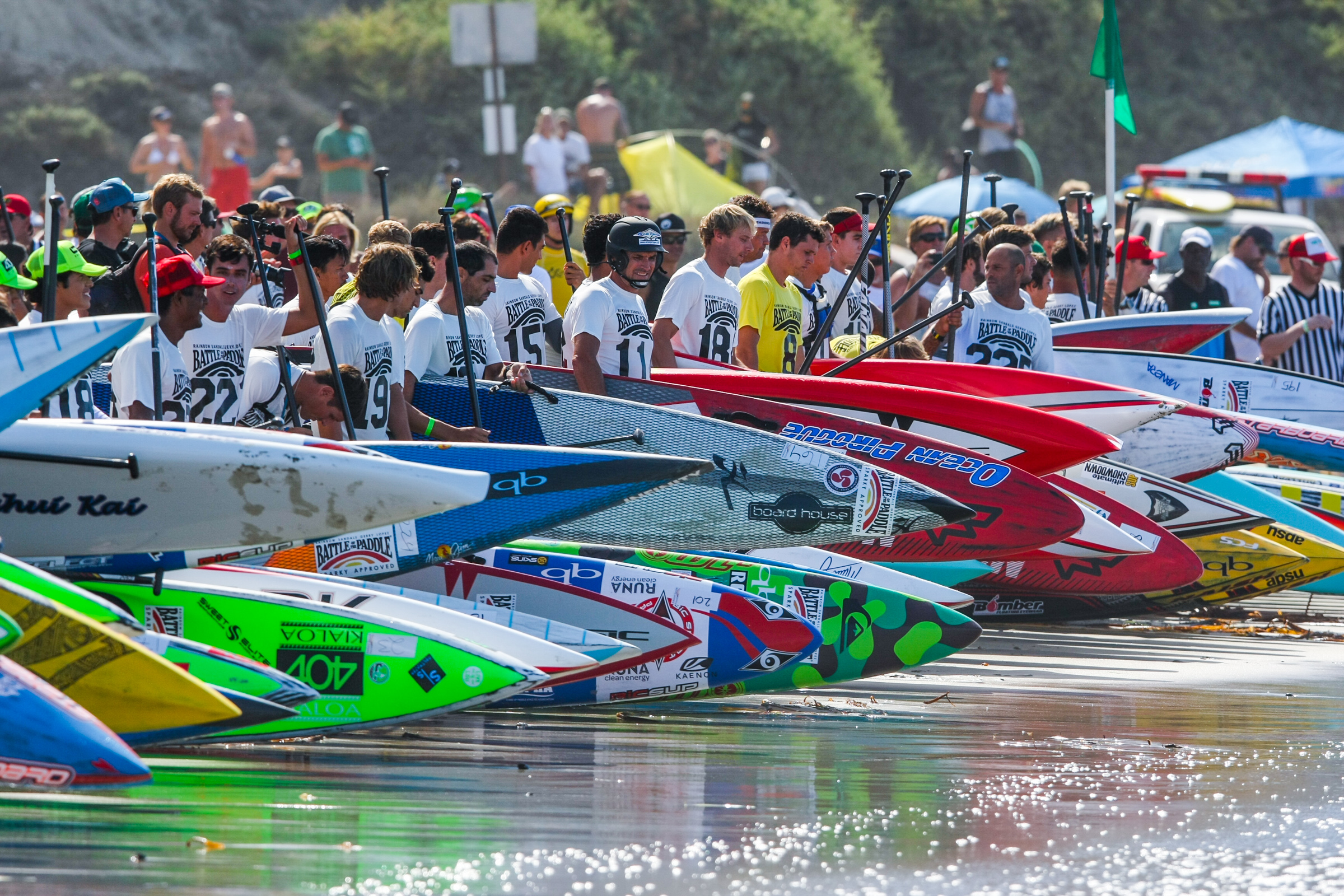 Contestants line up on Salt Creek Beach prior to the start of a race at the Battle of the Paddle. Photo: Tony Tribolet/www.xpsphoto.com