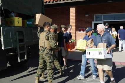 SJC Rotary members load a Marine truck during the Nov. 22 food drive. Photo: Courtesy of John Caldwell
