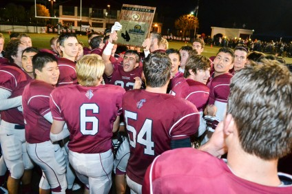 The St. Margaret's football team celebrates winning the CIF-SS East Valley Division Championship. Photo: KDahlgren Photography