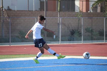 Sophomore Jovanni Almovodar sends a ball into the box during a San Juan Hills boys soccer practice. Photo: Steve Breazeale