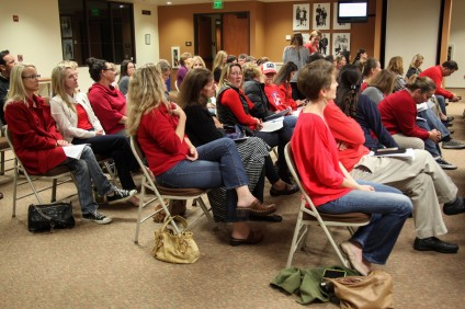 Dozens of parents concerned about the CUSD's school of choice policy showed solidarity by wearing red shirts at the Feb. 25 board meeting. Photo: Allison Jarrell