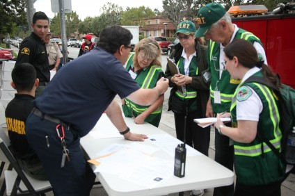 Many volunteers from San Juan Capistrano's Community Emergency Response Team helped install smoke alarms in condos in the La Zanja neighborhood on Feb. 21. Photo: Allison Jarrell