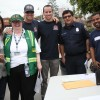 More than 150 volunteers, including many from San Juan's Community Emergency Response Team, installed smoke alarms in condos in the La Zanja neighborhood on Feb. 21. By Allison Jarrell