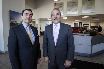 Rabin Godfrey, USA country manager for Grupo Autofin Mexico, and Ahmad Yassin, general manager of Imperio Nissan San Juan Capistrano. Photo: Allison Jarrell