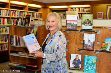 Donna Friess with her new novel, The Unraveling of Shelby Forrest. Photo: Courtesy of Scott Schmitt