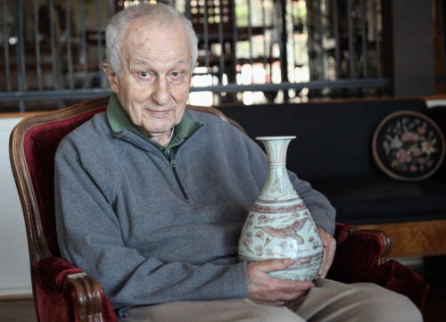 Former councilmember Roy Byrnes holds a ceramic piece from his collection dating back to 13th century Yuan Dynasty. Upon retiring from the dais, Byrnes said he plans to focus on studying Chinese ceramics of the Ming Dynasty. Photo: Allison Jarrell