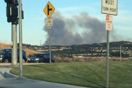 Smoke was seen rising up from behind San Clemente shortly before sunset Wednesday due to a brush fire on Camp Pendleton. Photo: Wendy Imatani Peloso