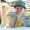 Sequoia Baird, 2, of Newport Beach, works on a coloring book during the Ecology Center's annual Earth Day event. Photo: Allison Jarrell