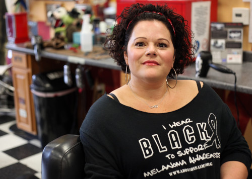 San Juan Capistrano resident Kristi Donahue often talks to her clients at Stew's Barber Shop in Ladera Ranch about the dangers of melanoma and protecting their skin. Photo: Allison Jarrell