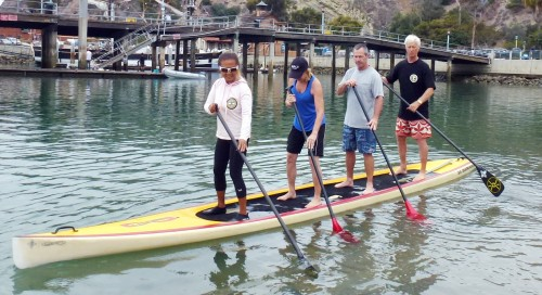 (L to R): Barrie Boehne, Gloria McLaughlin, Mac McLaughlin, Steve Boehne participate in stand-up paddle boarding on Saturday.
