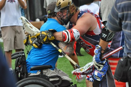A veteran and player embrace at the 2014 Shootout For Soldiers event in Baltimore, Maryland. Photo: Andrew Pope
