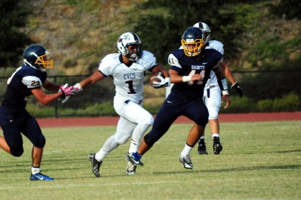 KciThompson, middle, and the Capistrano Valley Christian football team are looking for their first San Joaquin League title. in 2015. Photo: Courtesy CVCS Athletics