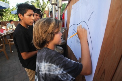 Young skaters sketch out ideas for a skatepark design during a summer workshop held at the Mission Grill. Photo: Allison Jarrell