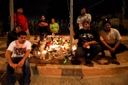 Friends and family of Cesar Medina gathered at a memorial for Medina on Saturday, Oct. 3. Many of Medina's friends stayed at the memorial, located at Del Obispo Street and Paseo Carolina, through the midnight hour. Photo: Allison Jarrell