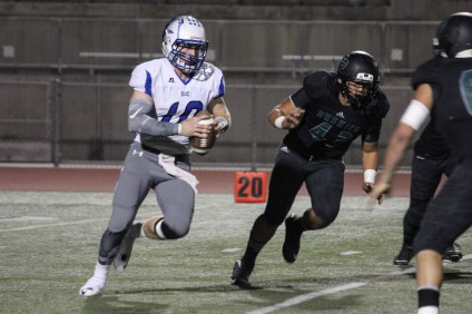 Saddleback Valley Christian quarterback Cade Henjum, seen here against Fairmont Prep on Oct. 24, threw for 204 yards and two touchdowns in the Warriors win over St. Margaret's on Nov. 20. Photo: Avery Chambers