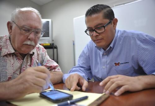 San Juan Capistrano resident Curtis Holman goes digital with help from Jose Juarez, Monarch HealthCare ambassador. Photo: