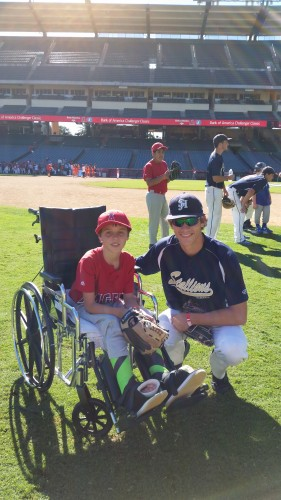 A San Juan Hills High School baseball player poses with a Little Leaguer during the Challenger Classic at Angels Stadium on Oct. 31. Photo: Gioia McCarthy