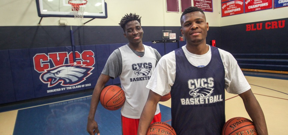 Capistrano Valley Christian School seniors Spider Adetunji, left, and Amazon Nwoye left their homes in Lagos, Nigeria to follow their dreams of playing basketball at the next level. Photo: Allison Jarrell