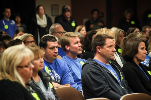 "More than 100 attendees at the Jan. 13 CUSD meeting wore ""Settle Now!"" stickers to show solidarity with district teachers as negotiations calling for higher pay continue. Photo: Allison Jarrell"