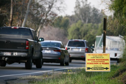 """Signs criticizing the City Council's decision to not approve the widening of a 0.9-mile stretch of Ortega Highway could be seen along the highway's """"choke point"""" on Jan. 19. The signs were placed by a local coalition of residents known as Capistrano Forward. Photo: Alex Paris"""
