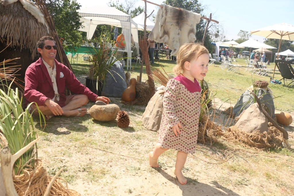 Adam Wright and his daughter Willow, 2, explore a replica native hut setting at San Mateo Campground during the Panhe celebration. Photo: Eric Heinz