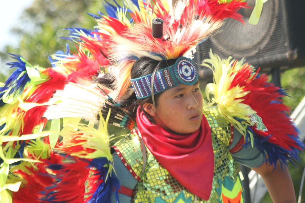 Baac Garcia of the Tohono O'odham nation performs a fancy feather dance during the Sunday, March 20, Panhe celebration. Photo: Eric Heinz