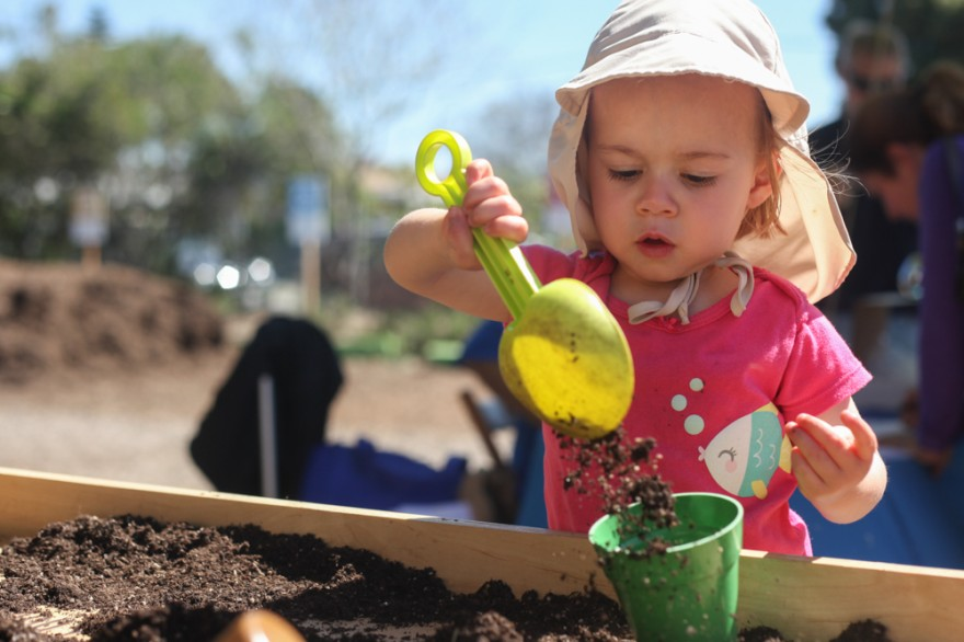 One-year-old Nora Behenna, of San Juan Capistrano, plays in the dirt during The Ecology Center's Grown Your Own! Spring Festival on April 16. Photo: Allison Jarrell