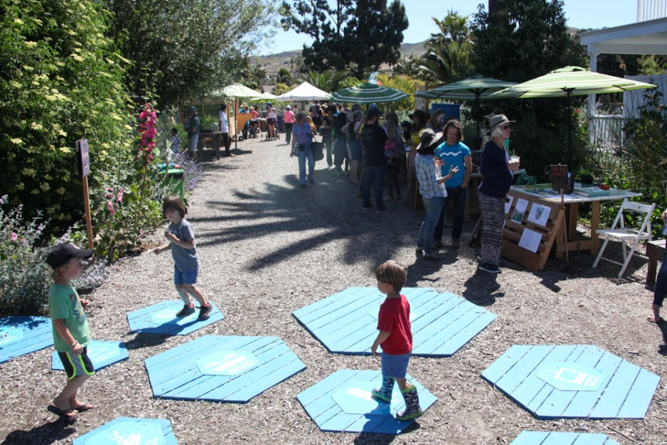 Visitors mosey between activity stations at The Ecology Center.